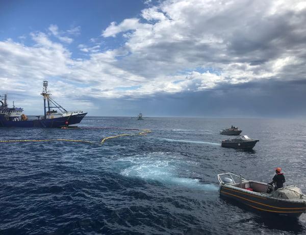 Ship and boats at the ocean