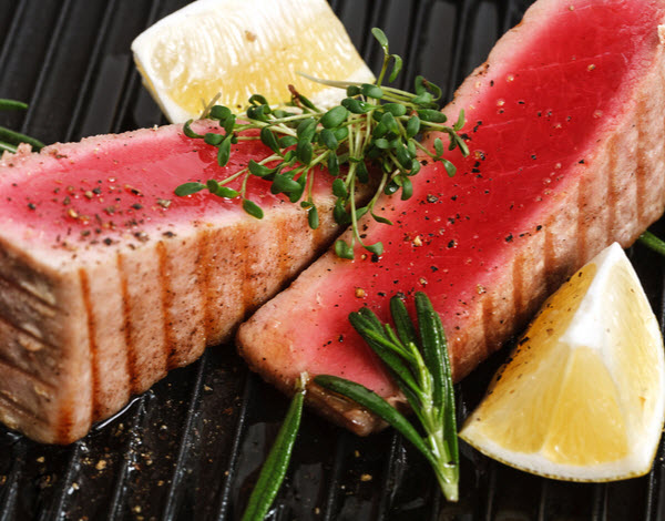 Grilled tuna with spice and lemon placed on a skillet