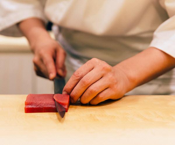 Chef cutting a bluefin tuna