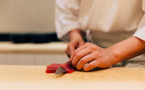 Chef slicing bluefin tuna