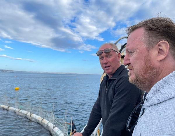 Men talking at the fishing site