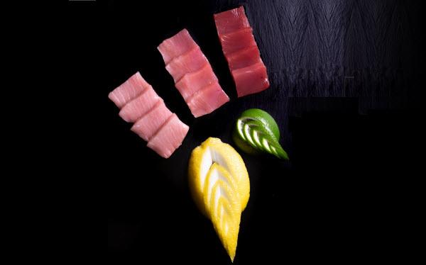 Tuna Sashimi plating on a black wooden board