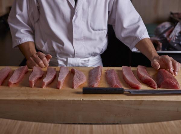 Chef slicing Tuna meat