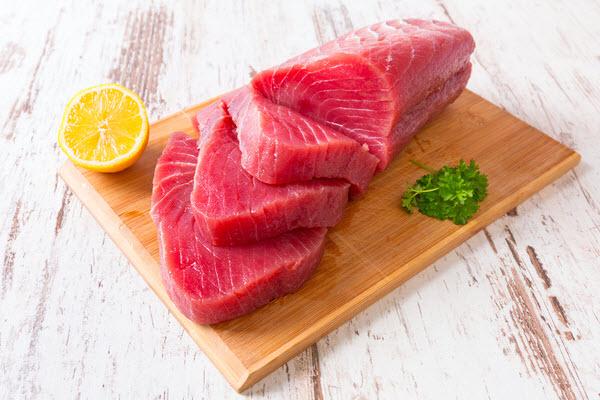 Sliced Raw Tuna steak on a wooden board